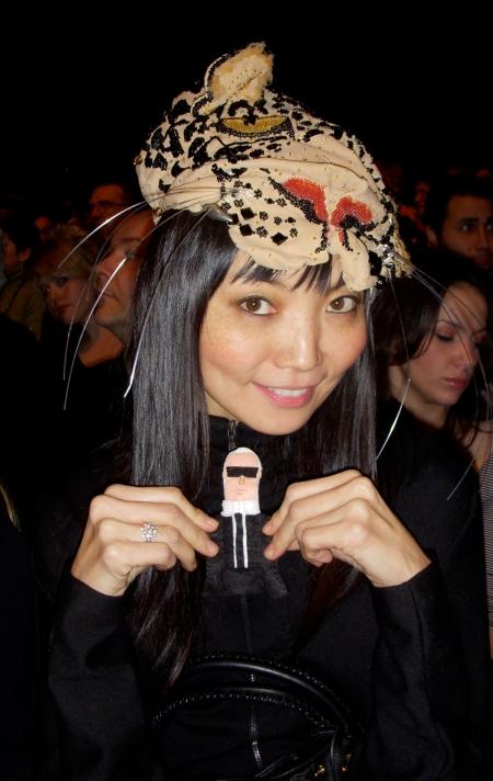 Karl adores Irina's Vivienne Westwood chapeau! Grrrrrrrrrr.